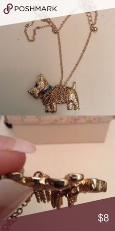 Adorable puppy dog necklace NWT Cutest puppy dog necklace with teal green diamond collar. Hanging chains  the chain measures 16 inches plus 2 inch extension chain. Jewelry Necklaces