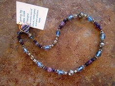 "Glass and metal beads with metal button clasp, approx. 16"",2010, by Sara MacIntyre, Steep Creek Designs"
