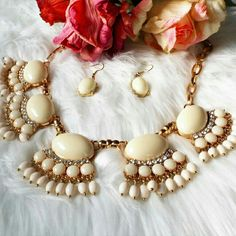 Setting New Trends In Ivory Statement Set This ivory statement set is calling your name. It is versatile so can be paired with many colors in your wardrobe. ?This set also comes with matching earrings. Jewelry Necklaces