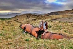 On the island of Kiska, Alaska, an abandoned Japanese midget submarine has lain silent in the grass that has consumed its former launch facility for decades. The abandoned wreck is now part of a Pacific war memorial.