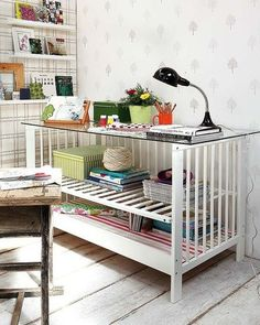 recycled crib, love this idea! Thrift stores have these out of date cribs very cheap. Flip one side for a shelf add a glass or any kind of top. Great for craft room, basement or home office.