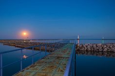 """The """"Blood Moon"""" looked more like the sun with the moisture vapor rising from Lake Michigan. Taken in Port Washington WI #yourhomeport"""