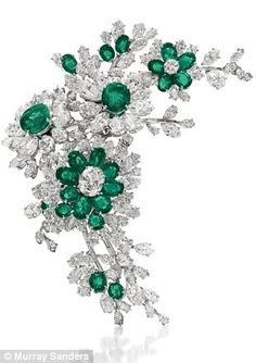 Emerald Queen: Taylor wore her beautiful Brooches in her hair, as well as on her Clothes - these are from her Collection of Bulgari Gems, Elizabeth Taylor Estate - an Emerald and Diamond Flower Brooch, by Bulgari. Sold at auction in December 2011 for 1,538,500.00 US