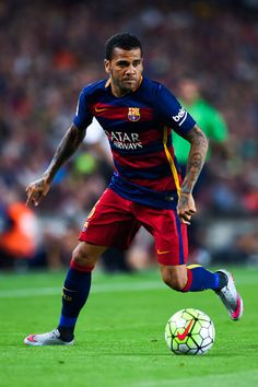 Dani Alves of FC Barcelona runs with the ball during the Joan Gamper trophy match at Camp Nou on August 5, 2015 in Barcelona, Catalonia.