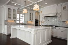 Marble kitchen with white island. Like the overhang which also makes the island a breakfast bar.