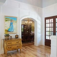 Trim instead of beadboard in a two-story foyer.