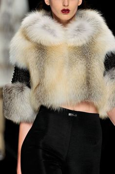 Such a pretty cropped fur top.  So chic and easily dresses up an outfit.  A sliver of skin showing makes for sexy winter outfit.