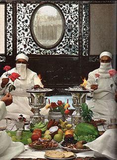 Parsi priests bless sacred food, Bombay, c. 1969