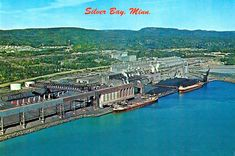"""Minnesota Postcard: Back of card reads, """"SILVER BAY, MINN. - Taconite Capitol of the World - Taconite Pellets are Produced Here by the Ton at Reserve Mining Co., World's Largest Taconite Plant. Silver Bay, Mining Company, Lake Superior, Worlds Largest, Minnesota, Paris Skyline, River, City, Places"""