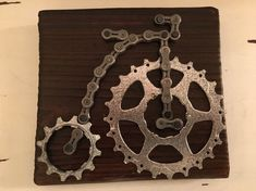 These hand made cycling wall plaques feature a Penny Farthing Bicycle and have been made by me from recycled bicycle parts and recycled pallet wood. The plaques are made from recycled bicycle chain and bicycle gears mounted on recycled pallet wood. Each one is approx 15cm long x