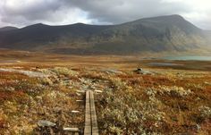 Summer hiking in Sweden's Arctic Circle - This September 2014 photo shows one of the many simple wooden walkways over vulnerable stretches of Sweden's popular Kungsleden trail.