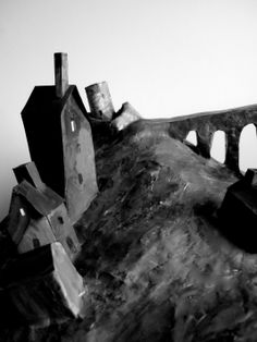 Village model made by artist Clive Hicks-Jenkins for 'The Mare's Tale' chamber-work. It was filmed and the footage screened as a backdrop to the orchestra during the performance. Since then it has been used as a compositional aid in the artist's studio.