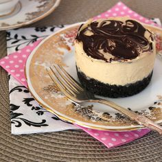Mini Baileys Cheesecakes: ◦200g Oreo cookies ◦100g butter, melted ◦200ml whipping cream ◦1 tsp vanilla extract ◦1/2 cup to 150ml Bailey's Irish Cream (depending on how alcoholic you like it) ◦1-2 tsp instant coffee dissolved in 1 tsp hot water ◦250g cream cheese, softened at room temperature ◦1/2 cup to 2/3 cup caster sugar (to taste) ◦20 grams dark chocolate, melted