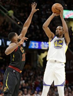 Golden State Warriors' Kevin Durant (35) shoots over Cleveland Cavaliers' Tristan Thompson (13) in the second half of an NBA basketball game, Monday, Jan. 15, 2018, in Cleveland. (AP Photo/Tony Dejak)