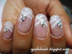 Stunning bridal nails from Cynful Nails. She uses a airbrush to create a beautiful criss cross pattern on the tips and accents with rhinestones. A perfect combination for the Bride who is looking for just a little extra bit not too much. - See more at: http://www.dailynails.com/nail-art?f[0]=field_theme%3A216#.dpuf