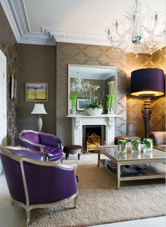 love the purple chairs, and the chandelier, and the huge lamp shade.