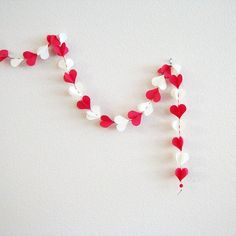 Items similar to Heart Garland red and white hand sewn with loop at top and beads at bottom on Etsy Heart Garland, White Wood, Multimedia, Red And White, Black, Hand Sewing, Bridal Shower, Dom, Unique Jewelry