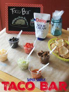 Kids in The Kitchen: Taco Bar for an easy weeknight dinner- there's a lot kids of all ages can do to help in the kitchen with this meal, and the squeeze pouch of sour cream means they can help with even more success.  DollopofDaisy AD