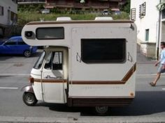 mini motorhome | Note the drop-down side panel to make a space big enough to sleep in.