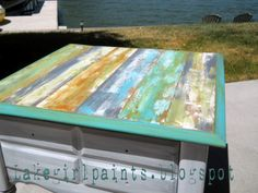 Lovin' this painted table...great in a beach house.