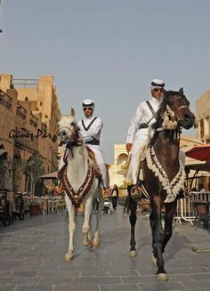 Mounted Police patrolling Souq Waqif - Doha, Qatar   - Explore the World with Travel Nerd Nici, one Country at a Time. http://TravelNerdNici.com