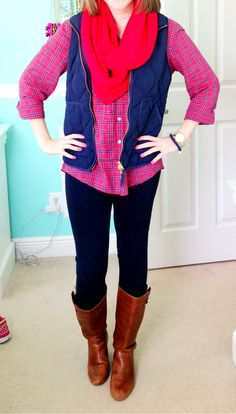 Plaid shirt, skinnies, scarf, and boots. Minus the vest.