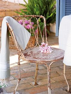 Love the old iron chair...