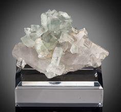 Heritage Auctions Minerals: Thumbnail, Euclase on Quartz. Equador. Borborema mineralprovince. Rio Grande do Norte. Brazil. 0.98 x2.76 x 0.51 in... (Total: 2 Items)