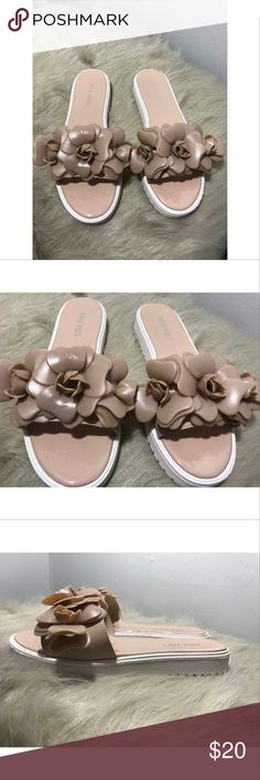 Nine West Flower Slides Sandals....Sz 6 Very cute Pinkish Tan Slides ....Good Condition ....some dirt on the bottom from wear....Fast shipping Nine West Shoes Sandals