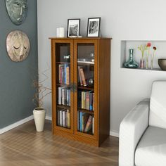 @Overstock.com - Inspired Cherry Glass Door Bookcase - Display your books and collectibles in the beautiful glass door bookcase. The inspired cherry finish and distinctive door handles will add a touch of elegance to your home or office.  http://www.overstock.com/Home-Garden/Inspired-Cherry-Glass-Door-Bookcase/7708614/product.html?CID=214117 $180.99