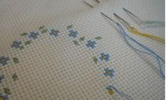 Tip: Parking threaded needles in Cross-stitch