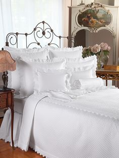 Dover - Like a rush of sea foam swirling around your toes, this whirling, twirling lace surrounds sumptuously soft 600 thread count Egyptian cotton sateen. Lovingly tailored in Italy, with White or Beige lace on pure white. Matching quilted blanket covers and shams are available on 300 thread count sateen.