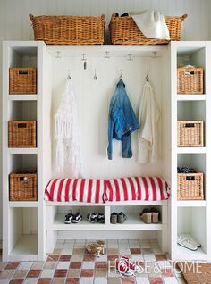This charming family-friendly mudroom unit was created using two narrow bookcases pushed against either side of a bench. | Photographer: Courtesy of Johner-Inside | Designer: Stephanie White