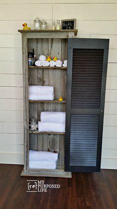 Reclaimed wood bathroom/guest room storage rustic shutter cabinet MyRepurposedLife.com
