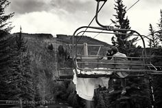 Bride & Groom on a ski lift overlooking the Eagle River just outside the Vail Cascade Resort in Vail Colorado.  September wedding just before the fall colors turned #frenzelstudios
