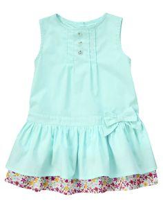 Pintucked Floral Hem Dress: Floral hem, bow and buttons on a fashionable poplin dress. Inspiration #Sew #SewforGirls #Dresses