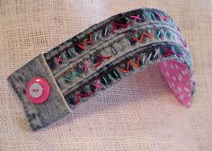 Denim Wrist Cuff Original Handmade Blue Jean Hand Embroidered Shabby Eco Chic Bracelet Upcycled itsyourcountryspirit. 34.99, via Etsy.