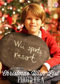 Snap photos in front of the tree of children holding a sign displaying the number one item on their wish list #photography