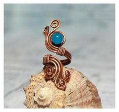 Hey, I found this really awesome Etsy listing at https://www.etsy.com/listing/534893593/swirl-ring-wirewrapped-ring-splint-ring