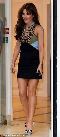 Loving the leopard print: Cheryl Cole matched her dress yto a pair of leopard print Charlotte Olympia heels