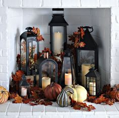 your fireplace as another space in your home to decorate for fall! Fill it with an array of lanterns and create a statement. You can also fill the lanterns with string lights, candles or leaves for a fall look!