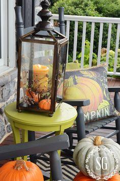FALL ROCKING CHAIR VIGNETTE-green table-lantern-stonegableblog.com candle on stand inside lantern