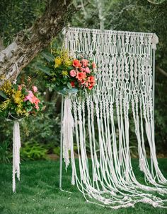 Such an interesting way to incorporate the woven wall hanging trend into a wedding - make it part of the ceremony backdrop