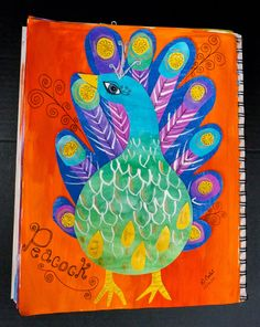 Now if you don't want to do a batik you can also create amazing peacocks in the art journal using painted papers.