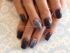 Acrylic nails with dark grey gel polish and gun metal glitter