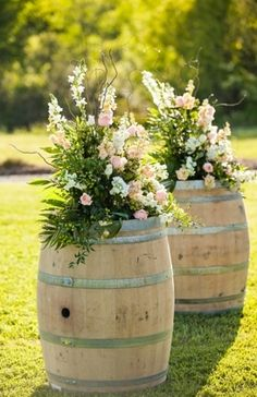 Gorgeous Rustic Wedding using wine barrels and flowers on top. #Weddings #WeddingDecorations