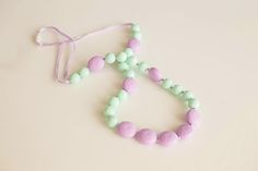 Natural teething relief by using  teether beads by  littleteether.com