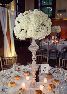 Get inspired: Simple #wedding tablescapes with tall white centerpieces.