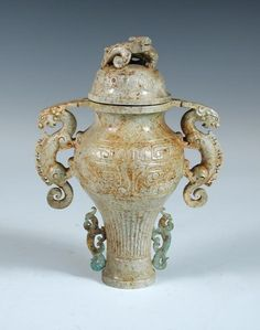 Sale D160415 Lot 111  A Chinese 'Chicken Bone' jade vase and cover, 21cm (8.25 in) high  - Cheffins