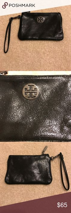 Tory burch Metallic wristlet dark silver/Pewter Tory burch Metallic wristlet dark silver/Pewter in  very nice gently worn clean conditionz it's like a pebbled shimmer leather in a dark silver metallic. Measures 7 inches across. My iPhone 7plus does not fit into it but a smaller version iPhone should.  No box or dust bag. No trades. Tory Burch Bags Clutches & Wristlets